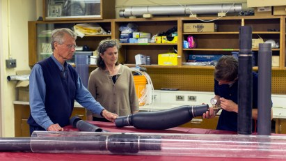 Beth Parker and John Cherry in the lab examining MLS parts