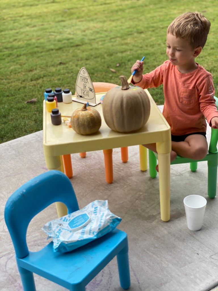 Toddler Painting with Pumpkins
