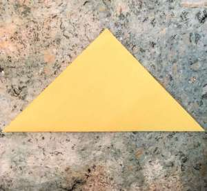 yellow construction paper folded into a triangle