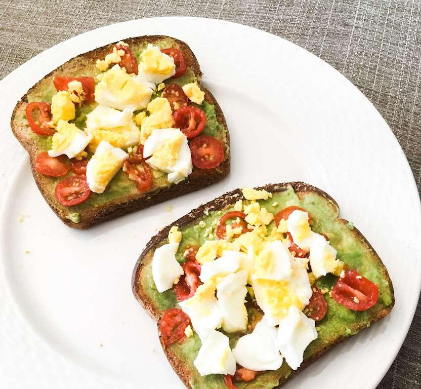 Avocado toast with cherry tomatoes and eggs