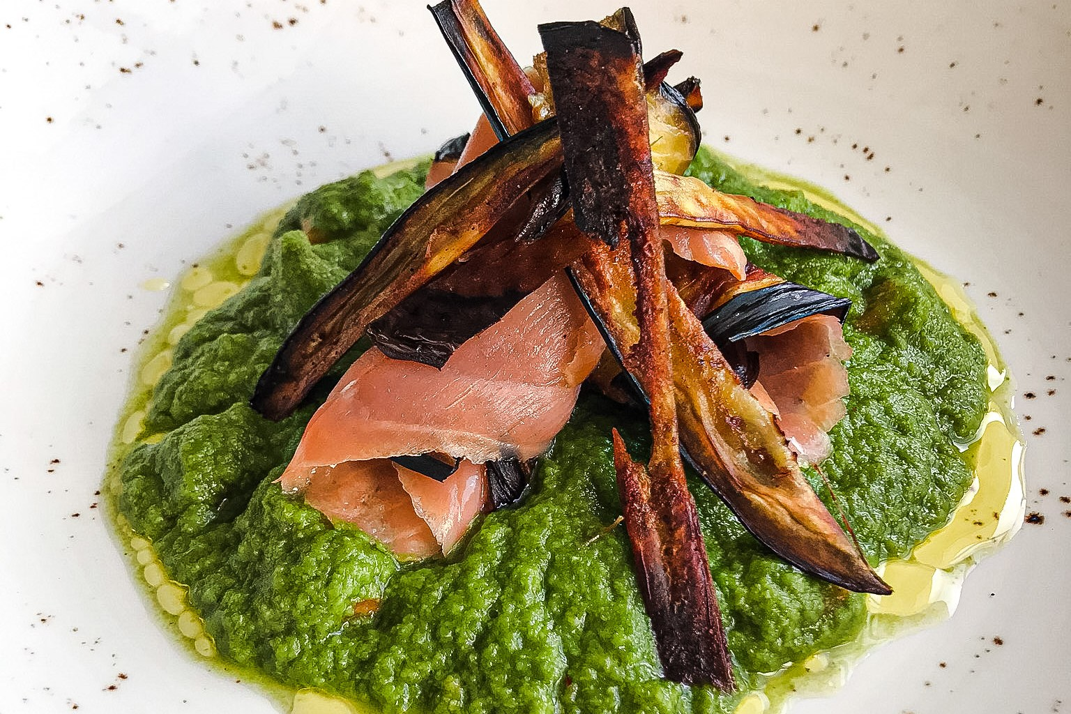 Aubergine chips with salmon and pea purée