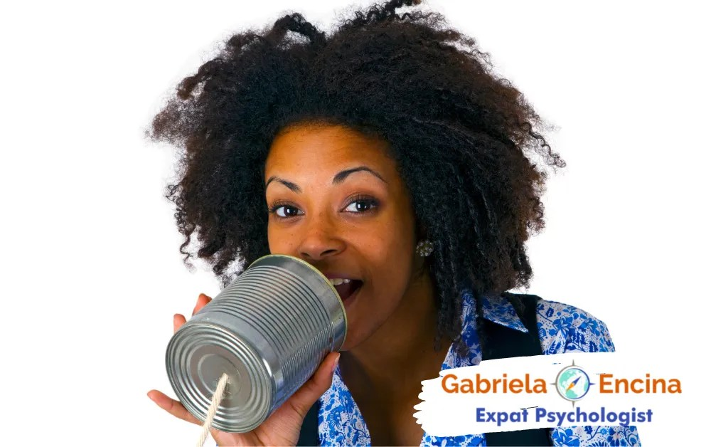 Coping with Expat Guilt in your Life Abroad - Gabriela Encina - Expat Psychologist Online - expat woman talking to a can phone