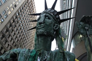 Large Lady Liberty puppet takes on Wall street. Photo by Gabrielle A. Wright.