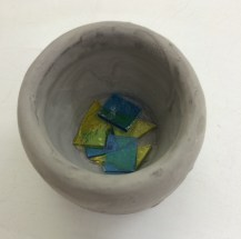 White stoneware with glaze and glass at the bottom, pre-firing (oxidation stoneware). Approx 6cm x 6cm x 6cm.