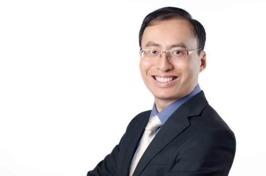 Studio business corporate headshot portrait of man against white backrop