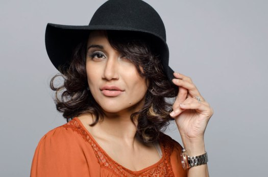 Beauty glamour portrait of a stylish Persian woman wearing a black hat