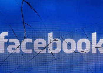 "(FILES) In this file photo taken on May 16, 2018 in Paris shows the logo of the social network Facebook on a broken screen of a mobile phone. Facebook said Tuesday it had shut down more than 30 fake pages and accounts involved in what appeared to be a ""coordinated"" attempt to sway public opinion on political issues ahead of November midterm elections, but cannot identify the source. / AFP PHOTO / JOEL SAGET"