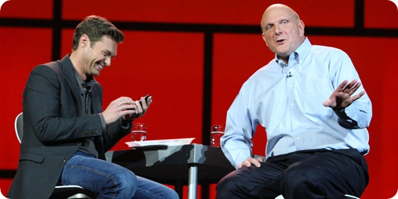 Microsoft CES Keynote host Ryan Seacrest checks out Steve Ballmer's Windows Phone.