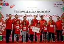 Sambut Natal, Telkomsel Bantu 5.000 Anak Yatim Piatu yang Kurang Mampu
