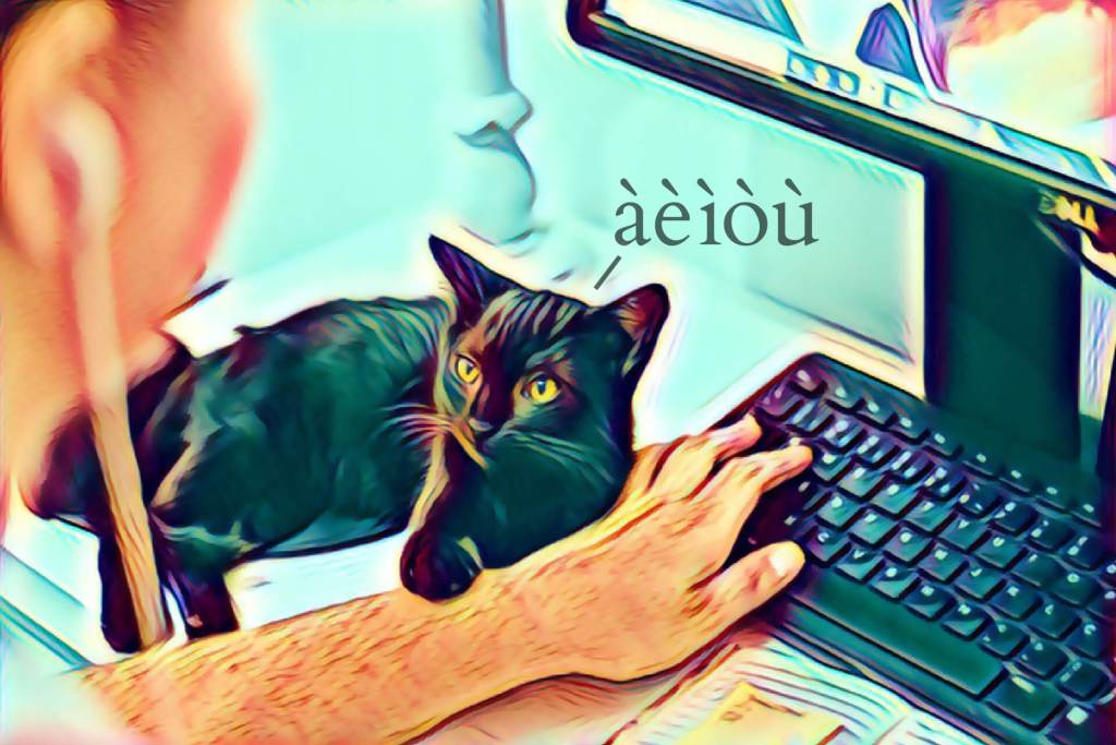 Black cat with owner and a computer keyboard, original image by Ruca Souza, CC0.