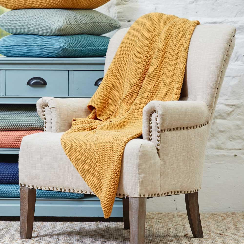 Moss Stitch Honeygold throw, €79.95 at Meadows & Byrne