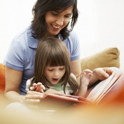 Mother reading to child -- Image by © Royalty-Free/Corbis