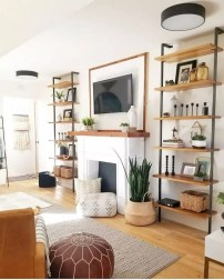 Delicate Living Room Design Ideas With Fireplace To Keep You Warm This Winter 28