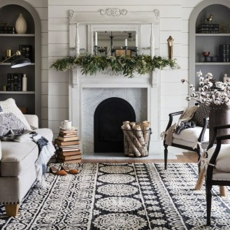 Delicate Living Room Design Ideas With Fireplace To Keep You Warm This Winter 34