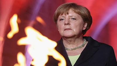 German Chancellor Angela Merkel commemorating the 100th anniversary of the World War I battle of Verdun | Sean Gallup/Getty Images