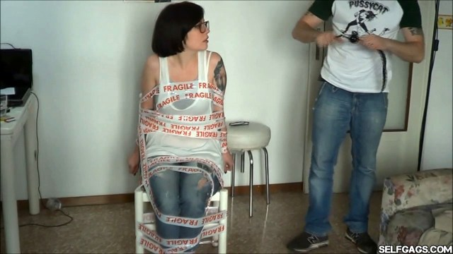 annoying girlfriend taped to chair