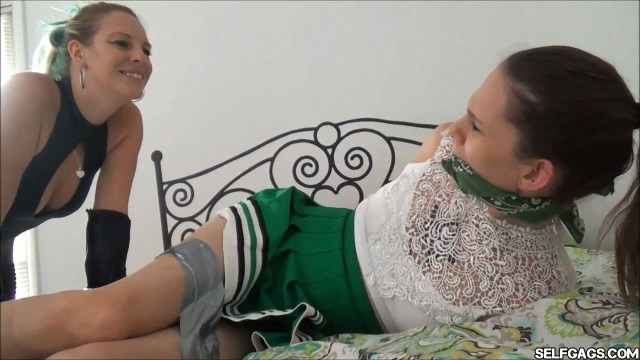 Cheerleader wakes up tied up and cleave gagged selfgags