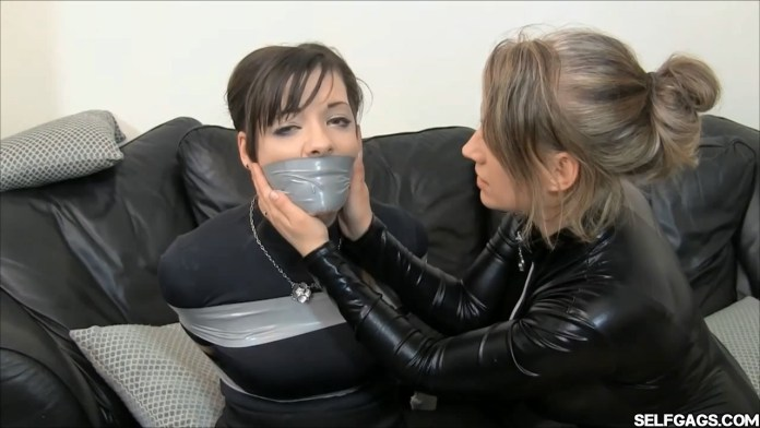 tape bound and tape gagged girl gagged by other woman