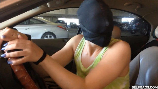 Tied and gagged girl screams for help in the parking basement