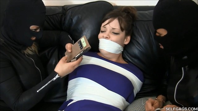 girl taped up and tapegagged by other girls
