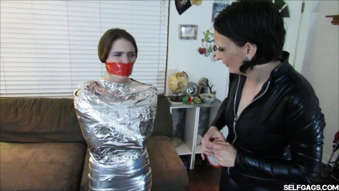 Young girl wraparound tapegagged in tight mummification bondage selfgags