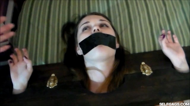 Young girl tape gagged in stockade selfgags
