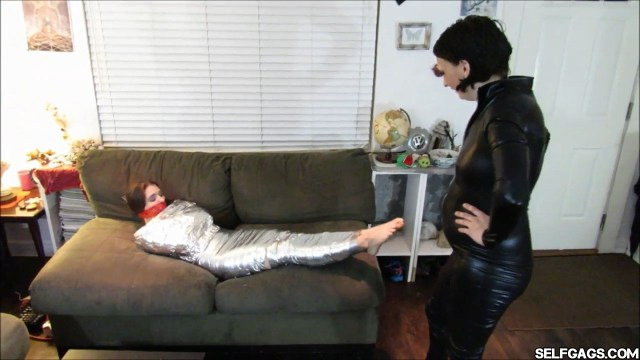 Mummified and tape gagged girl tries to escape selfgags