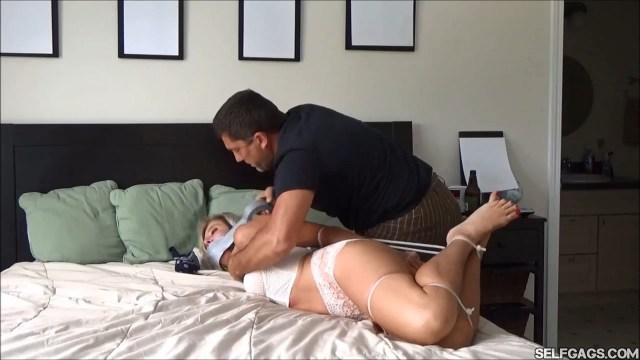 Hogtied wife tape gagged tight by husband selfgags