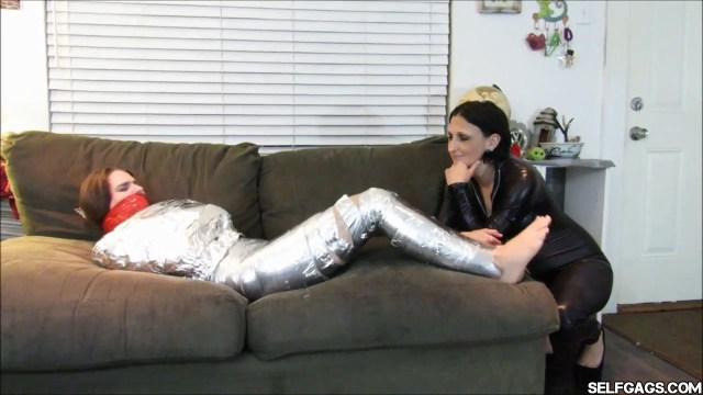 Young barefoot girl tape gagged in mummification bondage selfgags