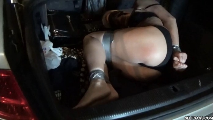 Mature real estate lady bound and gagged in car trunk selfgags