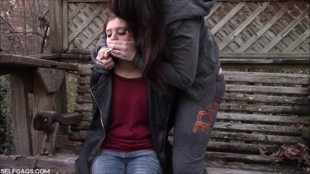 Tied girl forced to smoke through hand over mouth