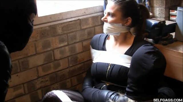 Tape gagged girl taped in tool shed by catsuit burglars selfgags