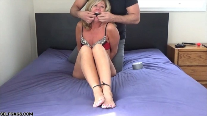 Milf Dakkota Grey zip tied and gagged by the lingerie bandit