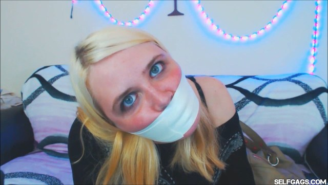 Blonde girl gagged tight with microfoam tape at selfgags.com