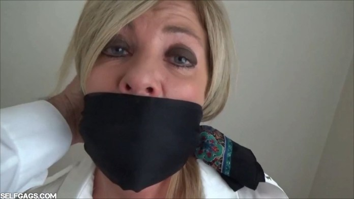 Dakkota Grey over the mouth gagged with a scarf