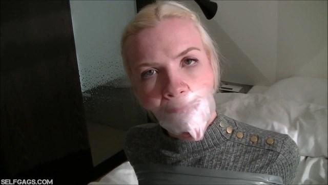Sock gagged girl tape gagged very tight