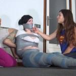 Girl tape gagged tight in tape bondage