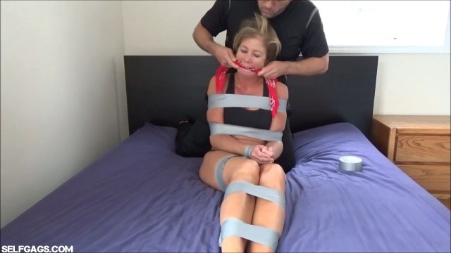 Sleeping milf tape gagged in bondage