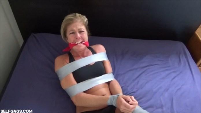 Dakkota Grey is a captured milf jogger in bondage