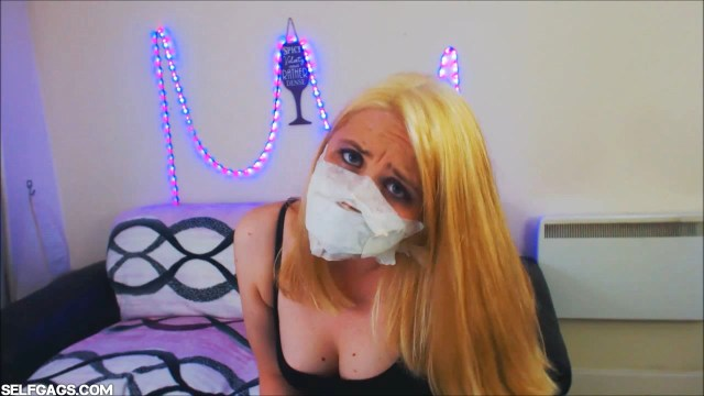 Girl gagged with over the nose otn tape gag