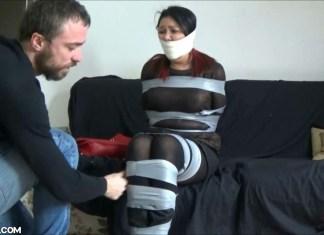 Girl gagged tight with microfoam tape in bondage