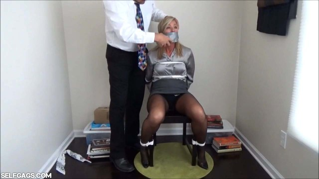 Chair tied woman gagged with tape