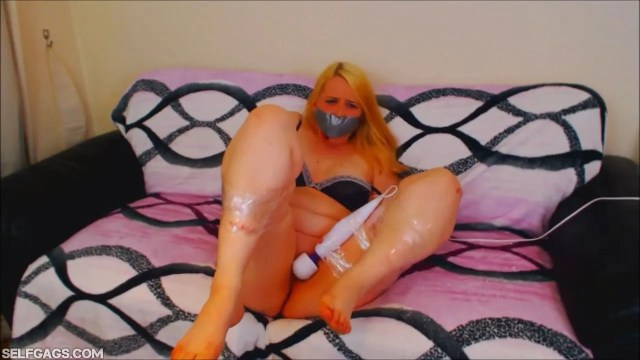 Tape gagged girl in bondage with vibrator tied to her pussy
