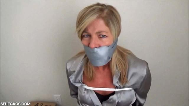 Dakkota Grey tape gagged tight