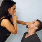Femdom woman handgags man