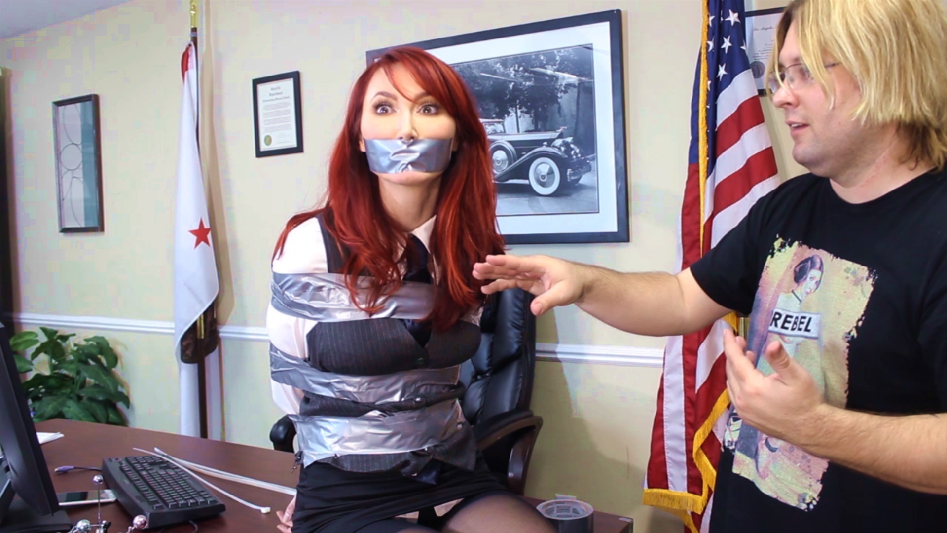 Redhead girl tied up in tape bondage