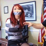 Tape gagged girl in bondage