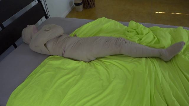 Luna Grey in mummification bondage