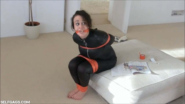 Bound and gagged girl barefoot in bondage