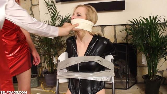 Chairtied girl with wraparound microfoam tapegag